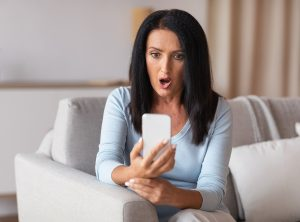 Female Shocked Looking at Mobile Phone
